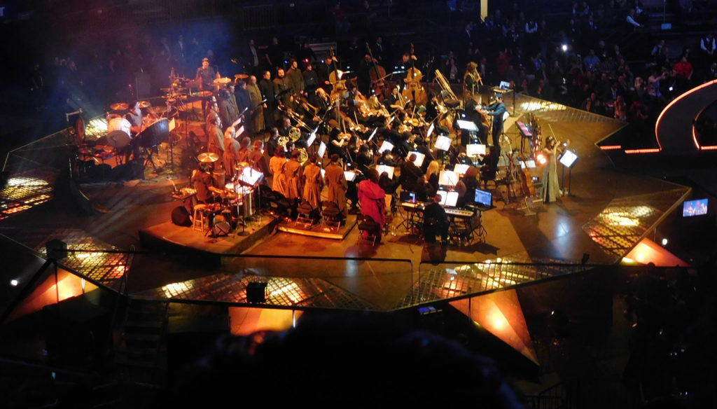 Ramin Djawadi conducting orchestra and choir